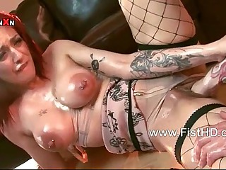 Super redhead Mai Bailey gets her pussy fisted with the addition of fucked
